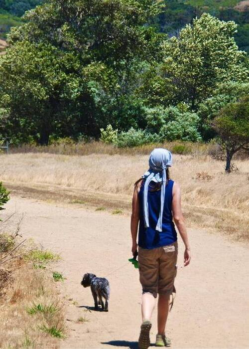 writer and teacher Jules Swales hiking with dog in santa monica mountains
